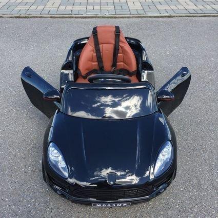 Электромобиль Porsche Macan черный (резиновые колеса, кожа, пульт, музыка)